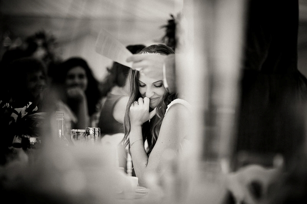 Bride smiling during wedding speech - Picture by Kristian Leven Photography