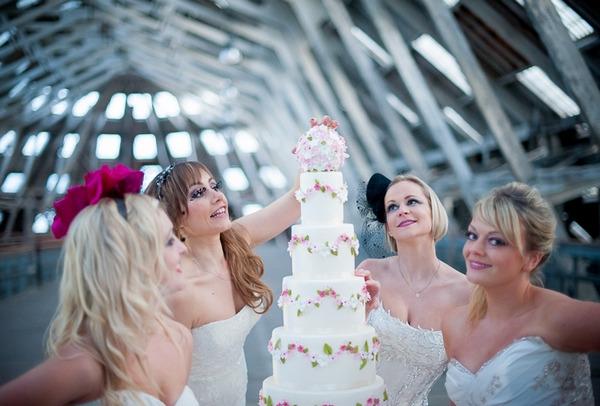 Brides looking at wedding cake