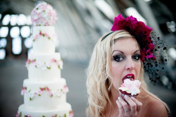 Bride eating cupcake