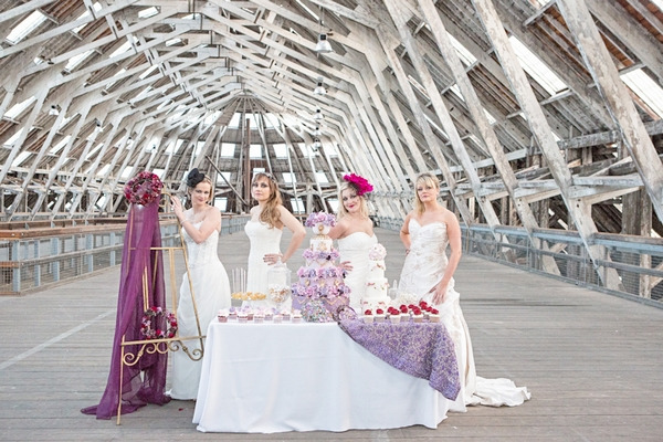 Four brides with cake table