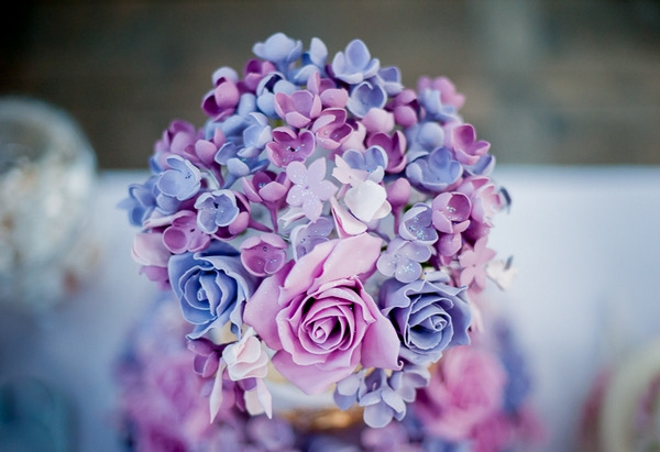 Flowers on top of purple wedding cake
