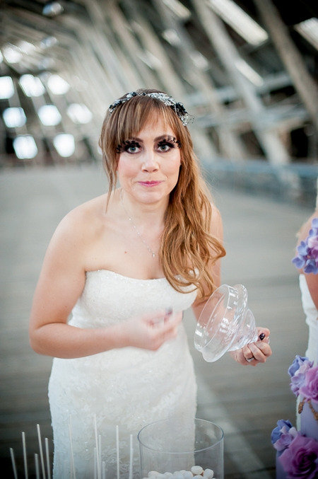 Bride looking at camera after eating sweet