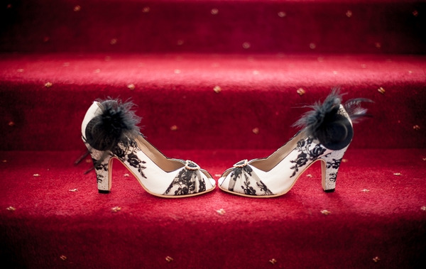 White and black wedding shoes on stairs