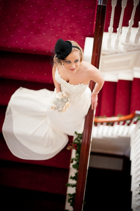 Bride standing on stairs looking up
