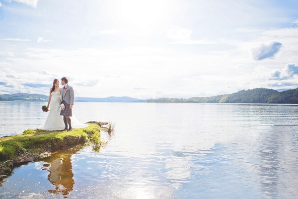 Bride and groom standing next to lake - Picture by Chantal Lachance-Gibson Photography