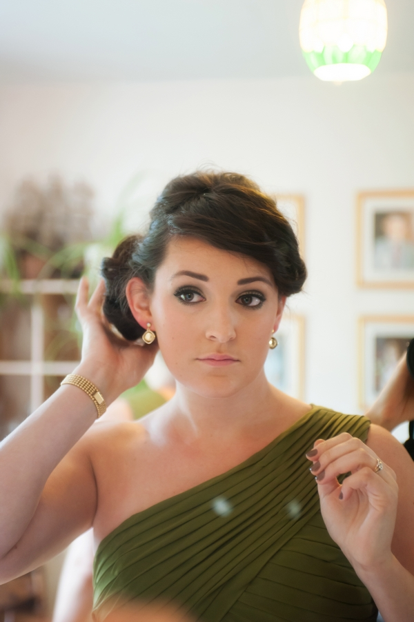 Bridesmaid adjusting hair