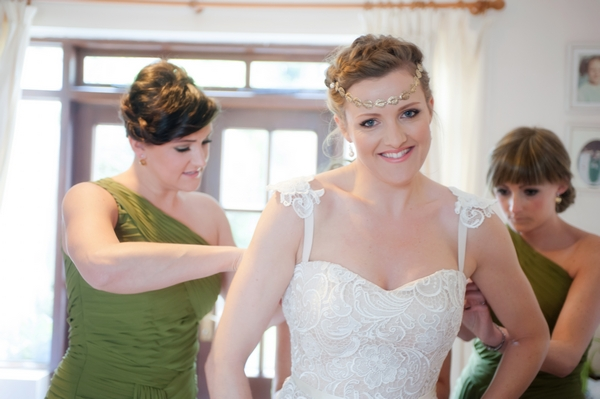 Bride being helped with her dress