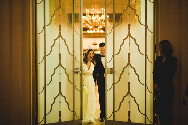 Bride and groom in between doors - Picture by Kristian Leven Photography