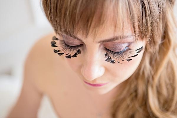 Long false eyelashes on bride
