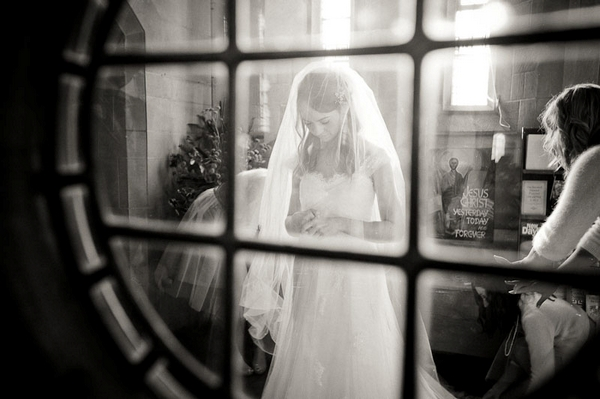 Bride through window - Picture by Kristian Leven Photography