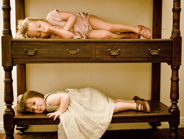 Young children laying down on cabineter - Picture by Kristian Leven Photography