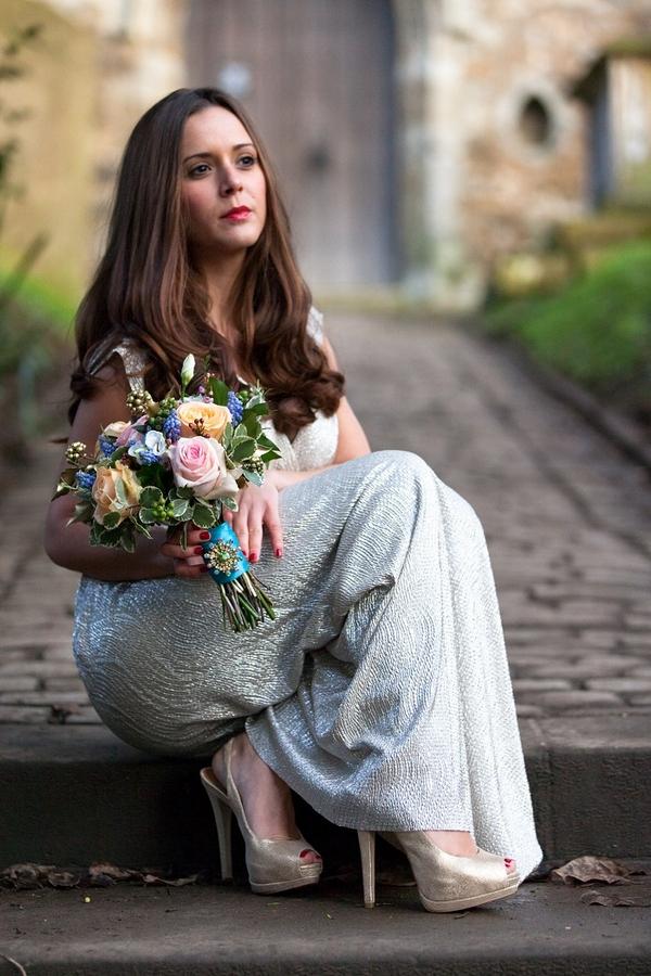 Bride sitting on step