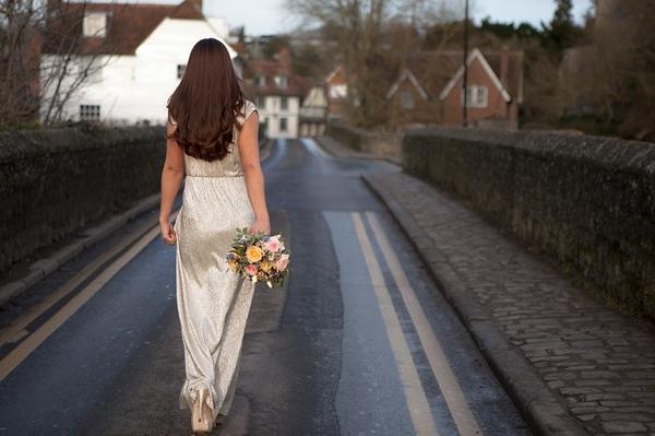 Bride walking down road
