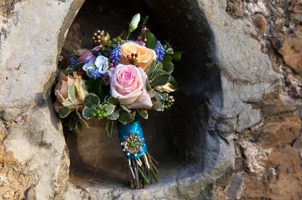 Bouquet in hole in wall
