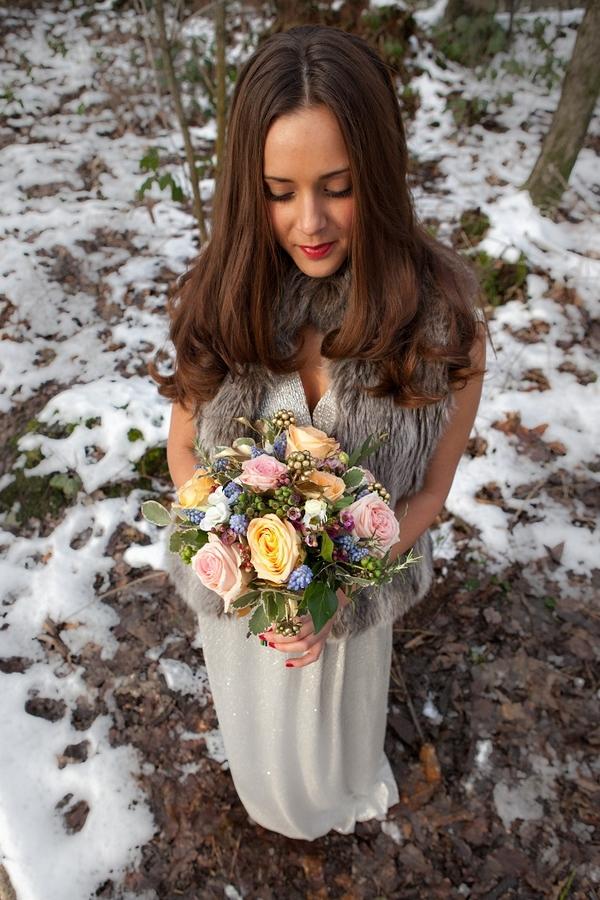 Bride holding pastel bridal bouquet