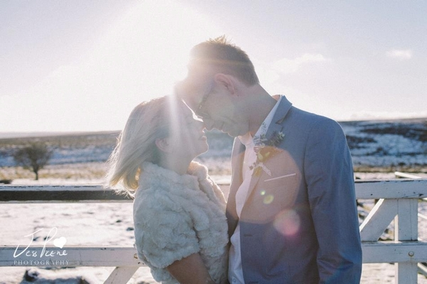 Bride and groom touching noses in the snow - Picture by Jess Petrie Photography