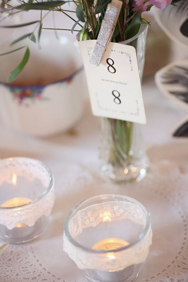 Candles and table number on wedding table
