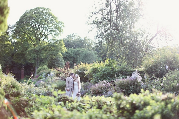 Bride and groom in Kirknewton Stables' gardens