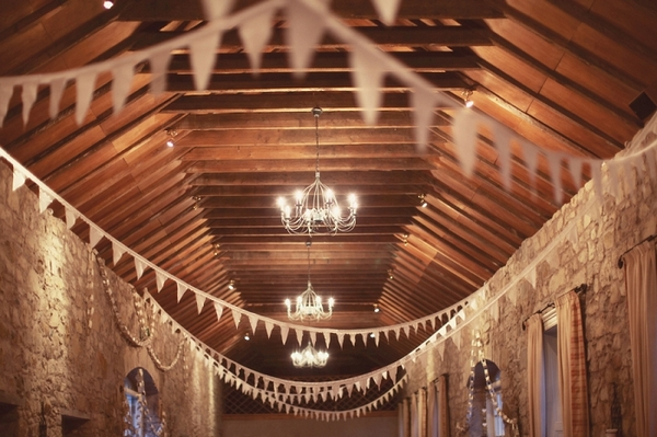 Bunting hanging from barn ceiling