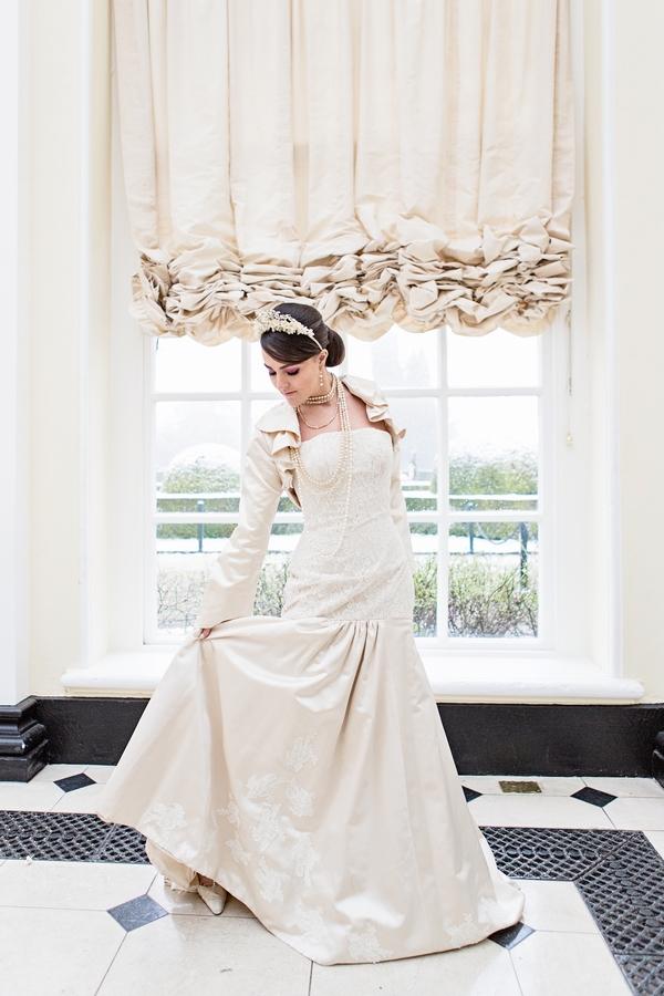 Bride holding up back of dress