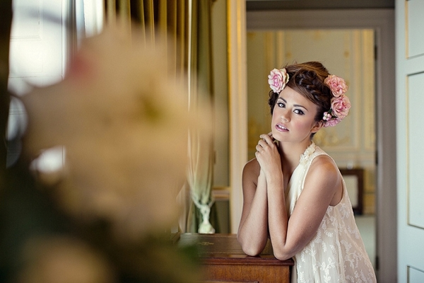 Bride with messy updo with flowers in hair
