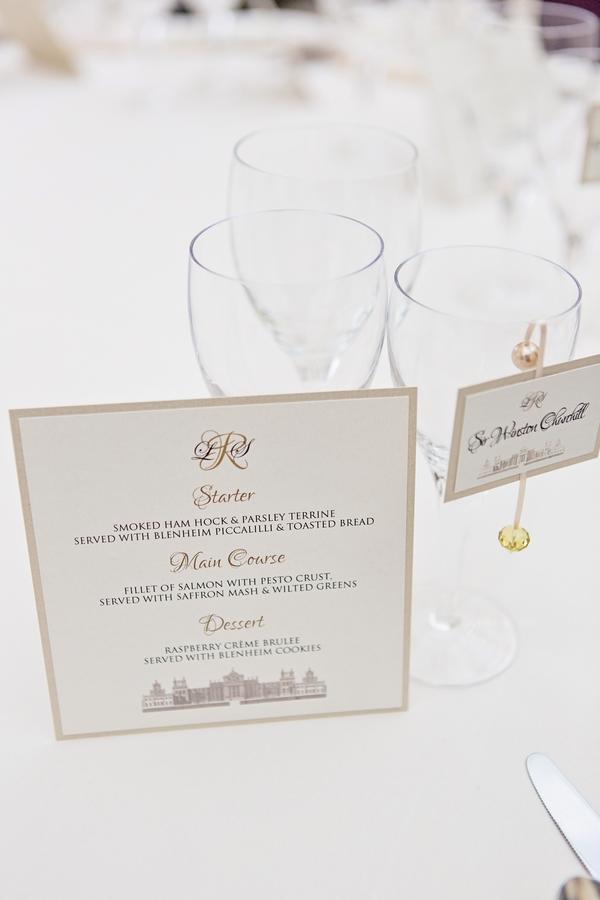 Wedding menu next to glass