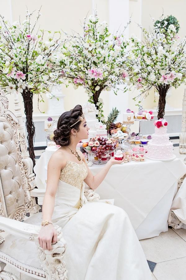 Bride sitting holding cupcake