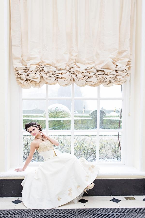 Bride laying across windowsill