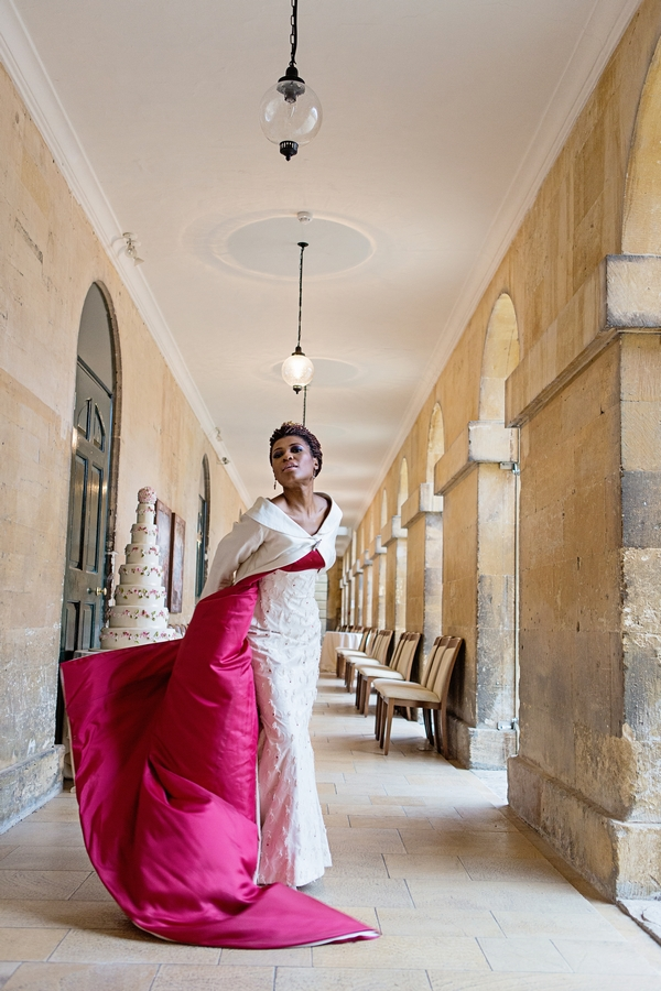 Bride with red-lined long wedding coat