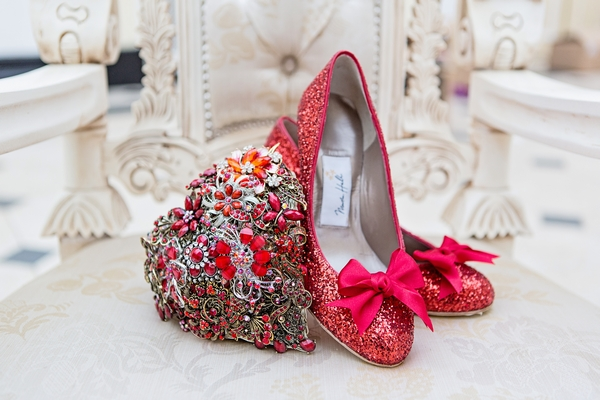 Red bridal shoes and heart brooch bouquet
