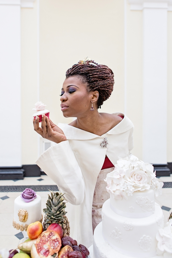 Bride holding cupcake