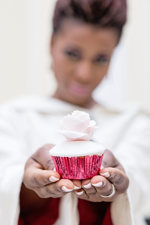 Bride holding out cupcake