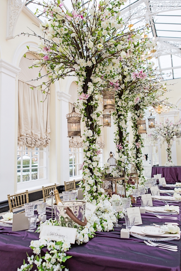 Long wedding table with trees