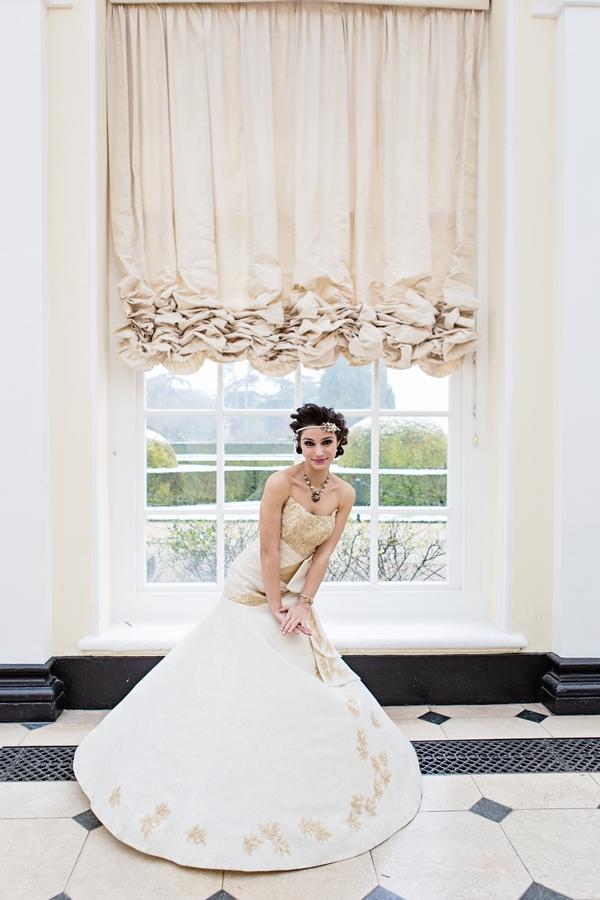 Bride in front of window