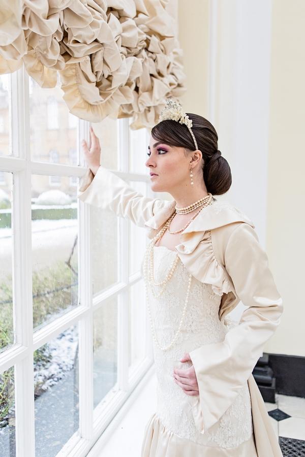 Bride leaning on window
