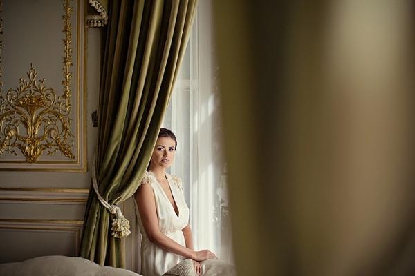 Bride sitting behing curtain