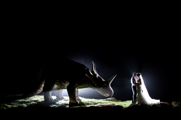 Bride and groom standing next to dinosaur - Picture by Katherine Ashdown Photography