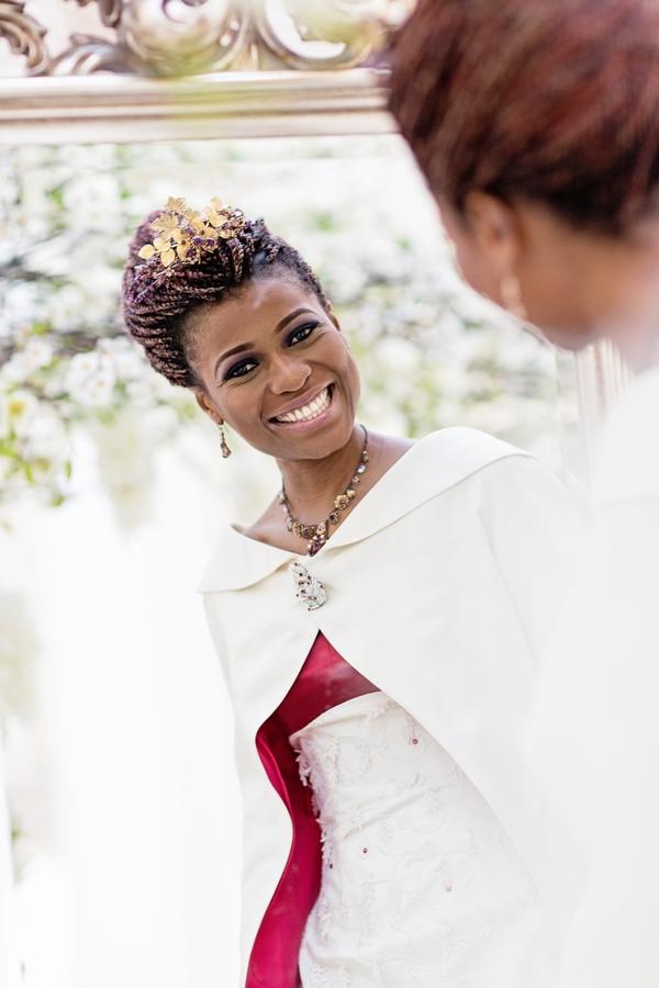 Bride smiling in mirror