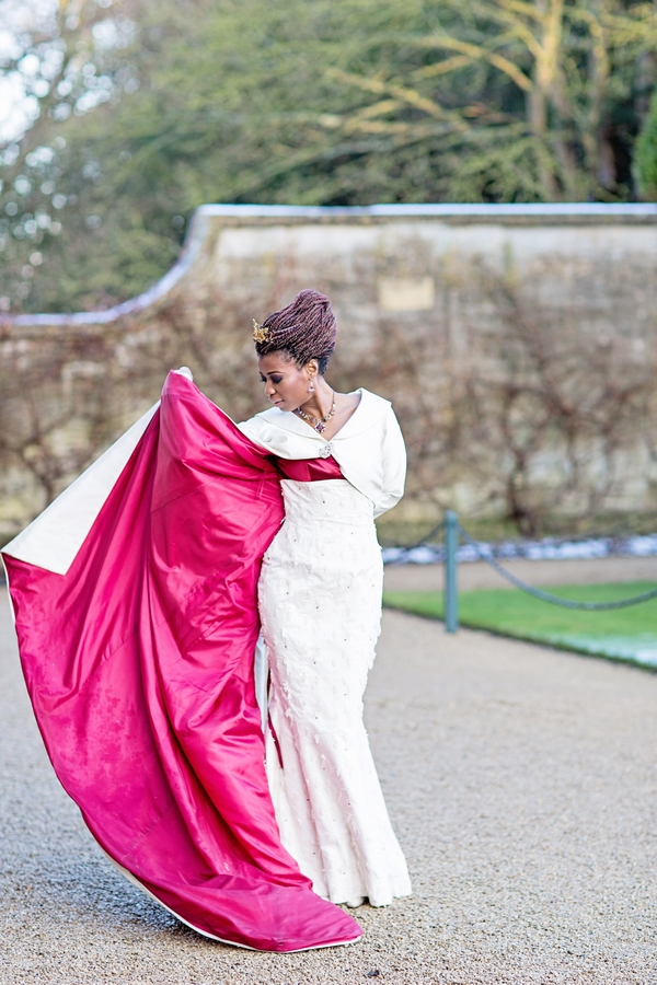 Bride with red-lined wedding coat