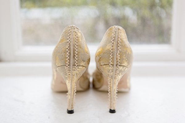 back of gold wedding shoes