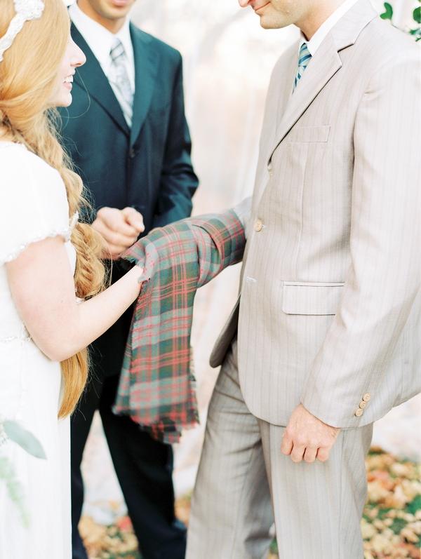 Clad Tartan over hands in wedding ceremony