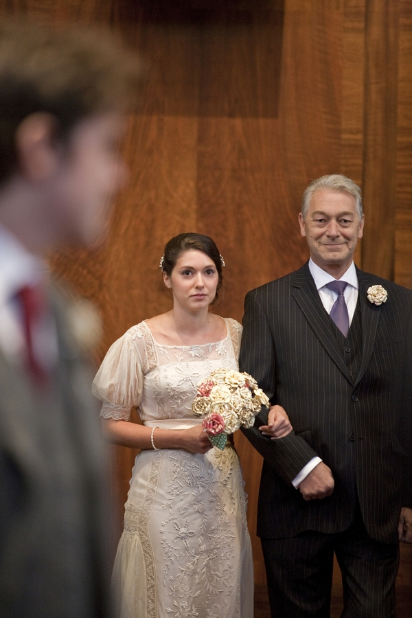 Bride walking with father into wedding ceremony