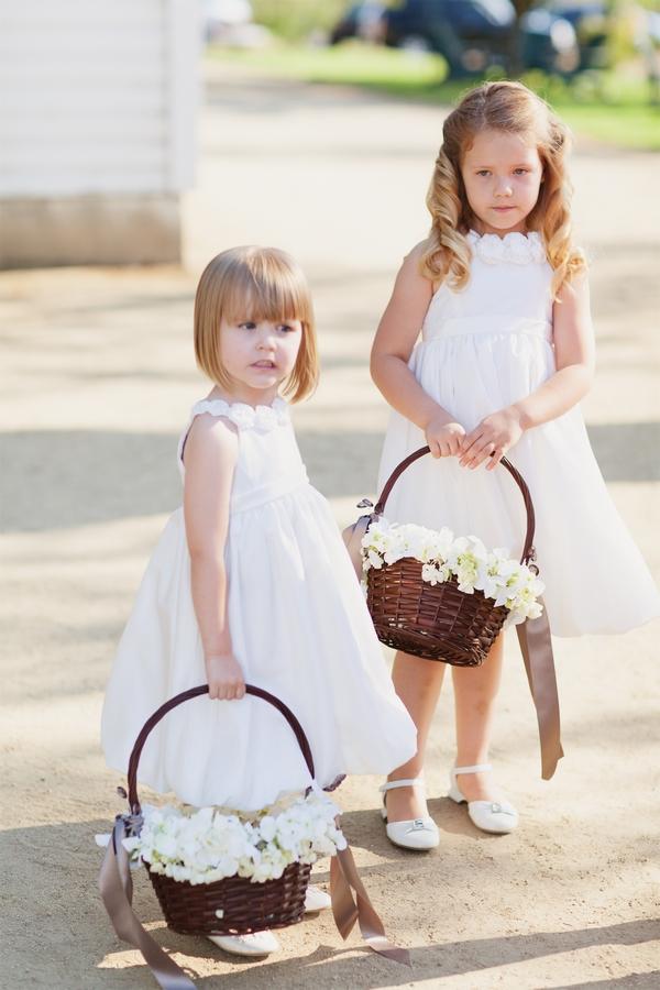 Flower girls holding baskets
