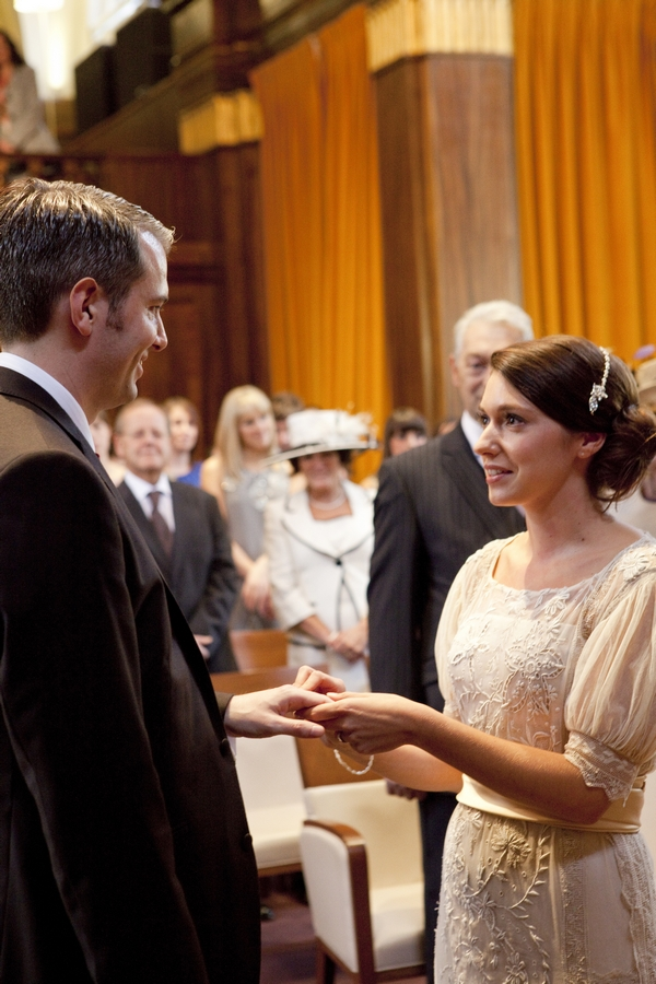 Bride and groom exchanging rings in Town Hall