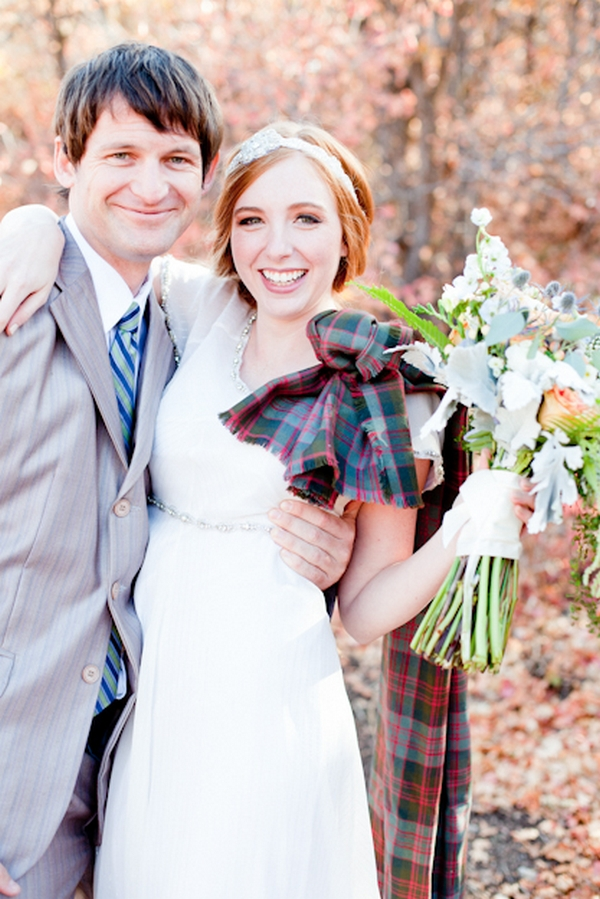 Bride holding bouquet with groom