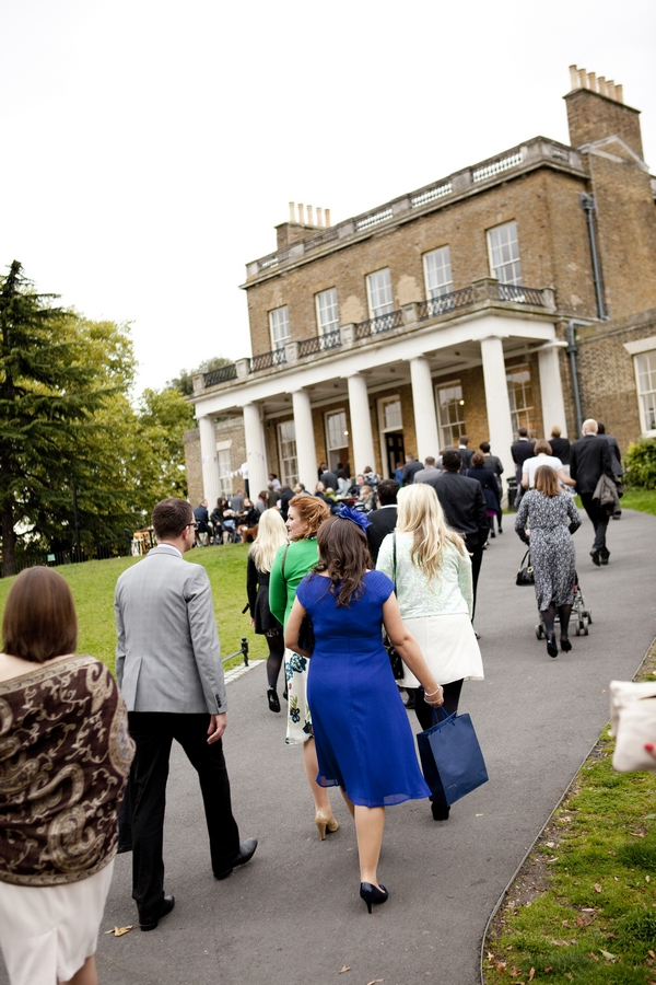 Wedding guests walking up to Clissold House