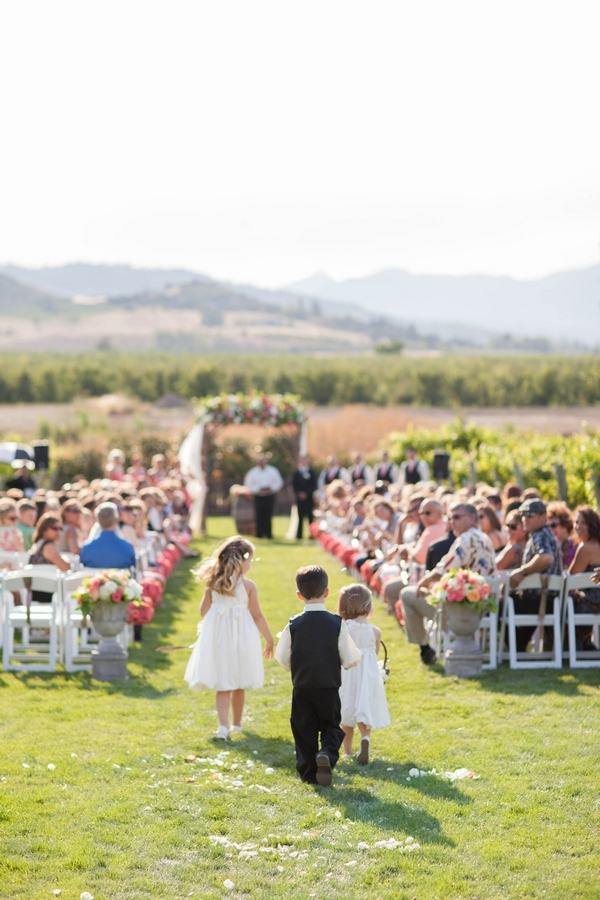 Pageboy and flower girls walking down aisle