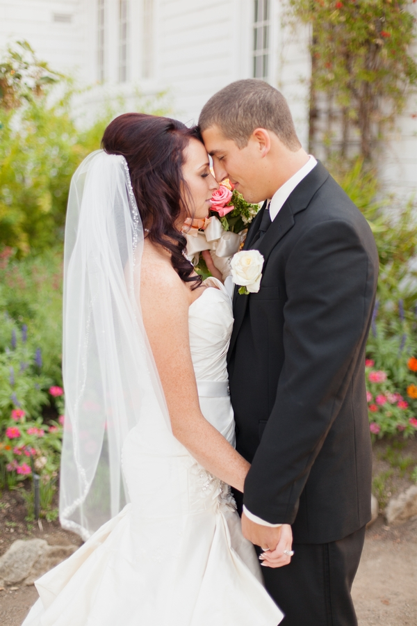 Bride and groom resting heads on each other