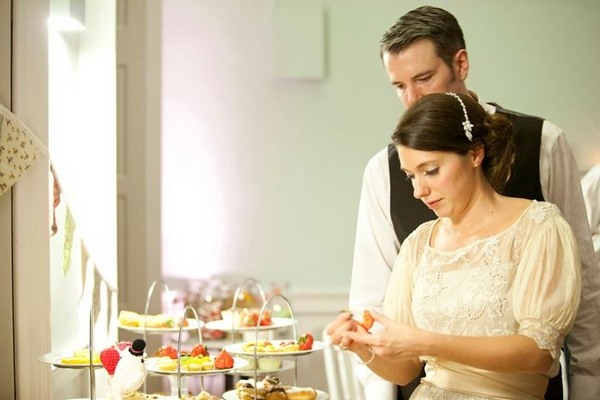 Bride and groom at sweet table