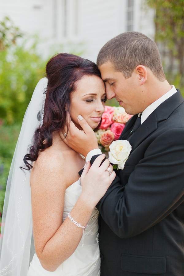 Grom holding bride's face